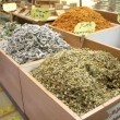 Camomile and other herbs and spices on display — Stock Photo
