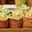 Mixed spices on display in sacks on market — Stock Photo