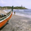 Boat at crowded beach, kerala, india — Stock Photo