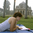 Woman reading book at lodhi gardens, delhi, india — Stock Photo