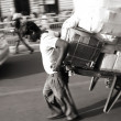 Man pulling cart laden with goods, delhi, india - Foto Stock