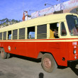 Red bus at bus station, south india - Stock Photo
