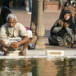 Old man performing ablution at Jama Masjid, Delhi, India - Stock Photo