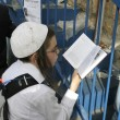 Stock Photo: Young Lag Ba'omer pilgrim reading Torah during festivities.