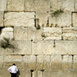 Man praying next to the wailing wall, jerusalem,israel - Stock Photo