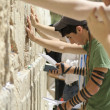 "Stock Photo: Young americ""birth right"" jews praying at wailing wall, jerusa"