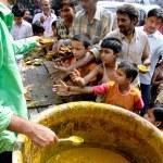 Children begging for food — Stock Photo