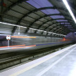 Stock Photo: Metro zooming past station, delhi, india