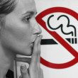 Stock Photo: Lady smoking a non-smoking panel