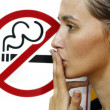 Lady smoking a non-smoking panel — Stock Photo