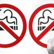 Couple smoking a no smoking sign — Stock Photo #8047627