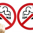 Couple smoking a no smoking sign — Stock Photo #8047629