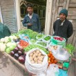 Men with vegetable stall - Stock Photo