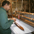 Weaver working handloom at workshop, delhi, india - Stock Photo