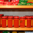 Jars of tomato sauce on the shelf in an organic shop - Photo