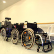 Wheel chairs parked in a hospital corridor — Stock Photo