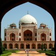 Stock Photo: Front view of humayun tomb framed by fort wall entrance