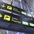 Gate sign panel in airport, madrid, spain — Stock Photo