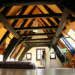 Room under the roof, with dark wooden beams — Stock Photo