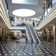Shopping mall and escalators - Stock Photo