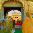 Sikh ladies entering the Golden Temple, amritsar, india - Stock Photo