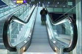 Person climbing on escalator — Stock Photo