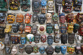 Masks on wall in nepal — Stock Photo