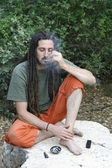 Hippy preparing, rolling and smoking marijuana joint : photos series — Stock Photo