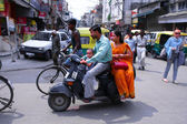 Family on scooter in dehi — Stock Photo