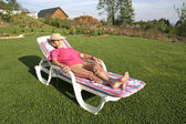 Woman pensioner enjoying her free time in garden — Stock Photo