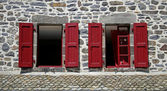Two windows with red shutters — Stock Photo