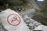 Communist inscription on rock in nepal annapurna trek — Stock Photo