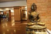 Buddha sitting in reception of hotel lobby — Stock Photo
