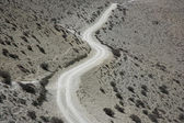 Winding dirt track on Annapuran circuit — ストック写真