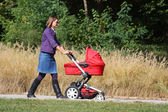 Mother and pram — Stock Photo