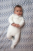Baby on pattern background — Стоковое фото