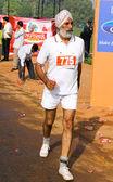 Elderly male marathon runner — Stock Photo