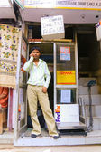 Young male shopkeeper — Stock Photo