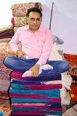 Man sitting on fabric — Stock Photo