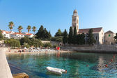 Hvar beach and church — Stock Photo