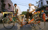 Rickshaw puller ferrying a passenger, delhi, india — Stock Photo