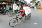 Man with bicycle rickshaw delivery — Stock Photo