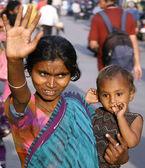Woman waving hand on the street, delhi, india — Stock Photo