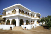 White hotel on the sea front in dahab, red sea, sinai, egypt — Stock Photo