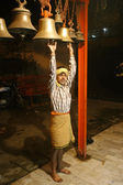 Man striking bells at temple, delhi, india — Stock Photo