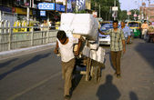 Man pulling cart laden with goods, delhi, india — Stock Photo