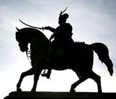 Ban Josip Jelacic and horse silhouette in evening sky on the main square in — Stock Photo