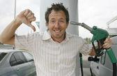 Man at petrol pump — Stock Photo