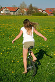 Unicycle and field — Stock Photo
