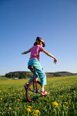 Riding unicycle — Stock Photo